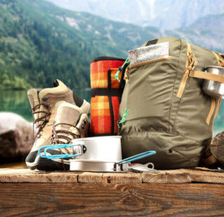 Camping equipment sitting on the wall against mountain background