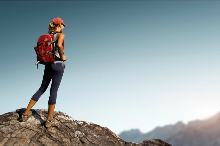 Woman with backpack on a day hike in mountains