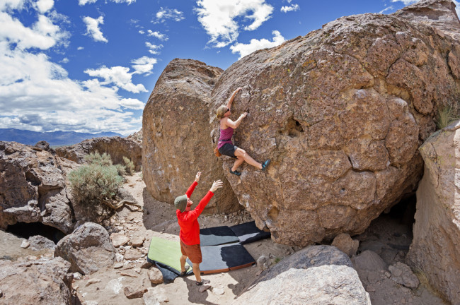 man and woman bouldering