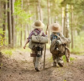 Children hiking in a forest