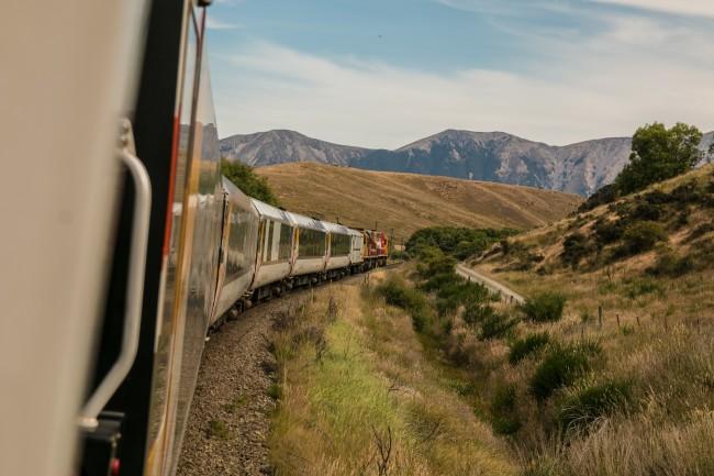 Train travelling through mountains