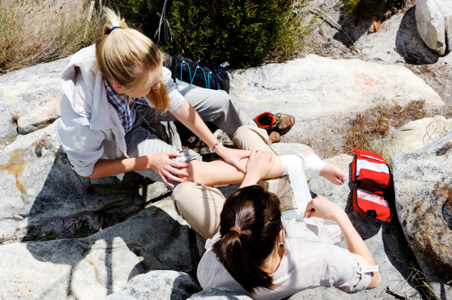 woman giving first aid outside