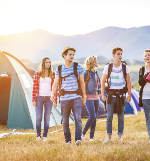 Young people camping at a music festival
