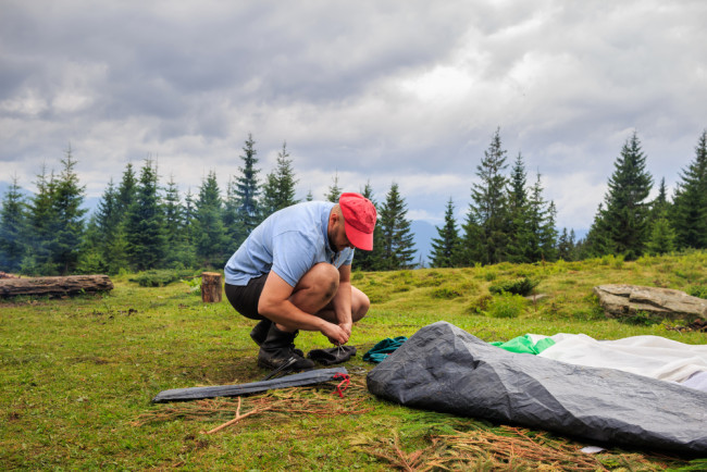 Man packing away his tent