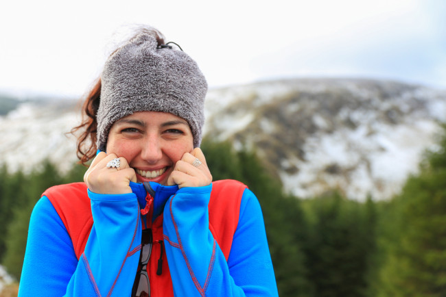 Woman wearing layered clothing outdoors