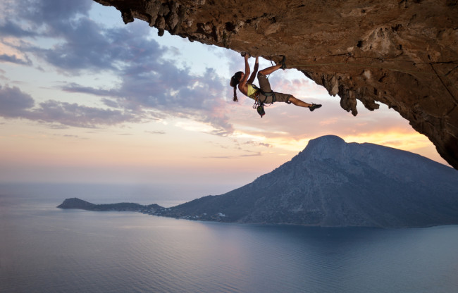 Woman rock climbing on an overhang