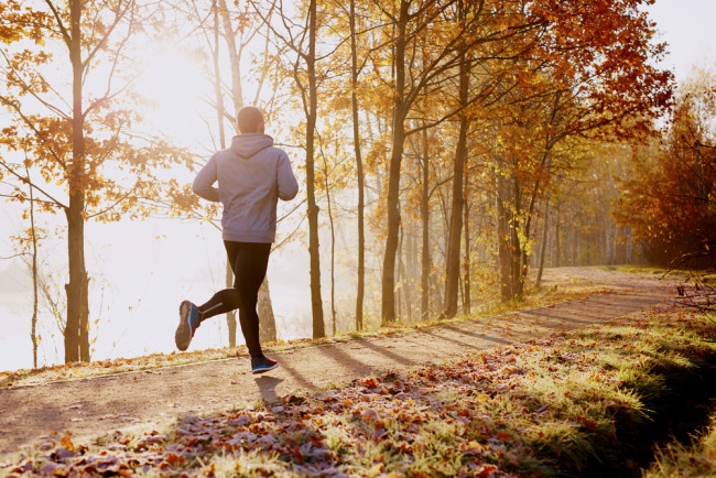 Man running in a forest in autumn