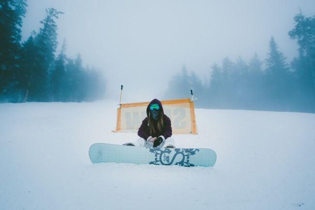 Snowboarder sitting down in the snow
