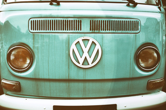 front of a green vw camper