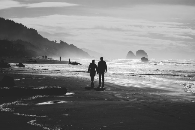 couple having a romantic walk on the beach