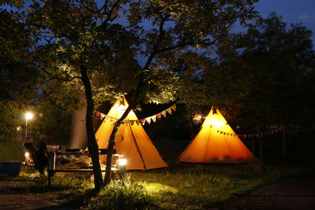 Glamping wigwams at night