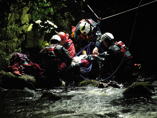 Mountain rescue saving someone in a river