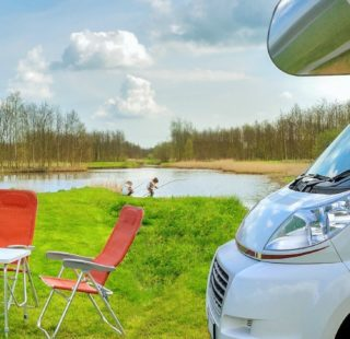 Drive away awning buying guide - campervan at a campsite