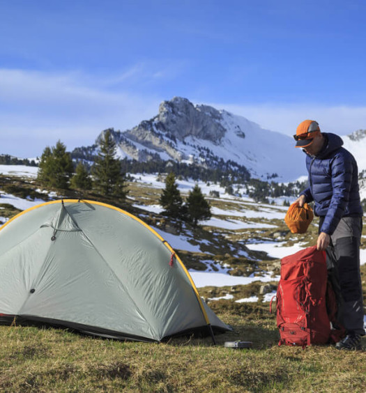 Man lightweight camping in mountains