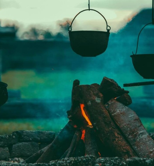 Campfire with pots hanging over it
