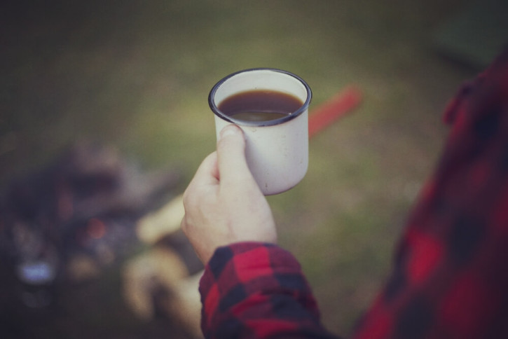 Man drinking cup of coffee at festival
