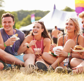 Young people eating at a music festival