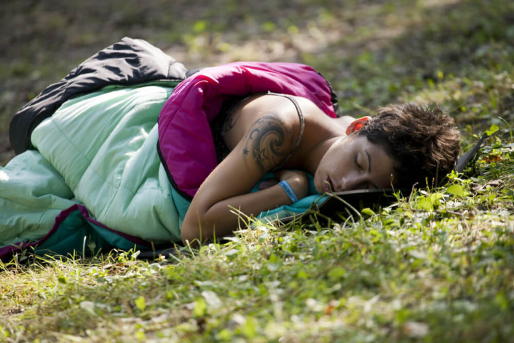 Woman sleeping at a music festival