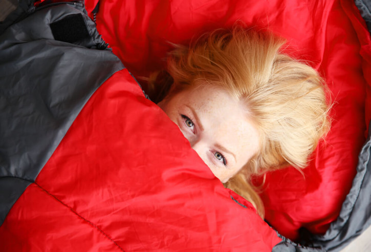 Woman in a red sleeping bag