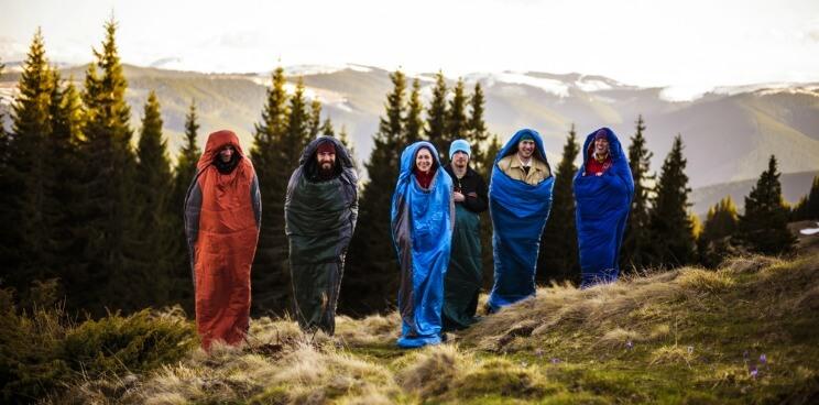 Group of friends in sleeping bags