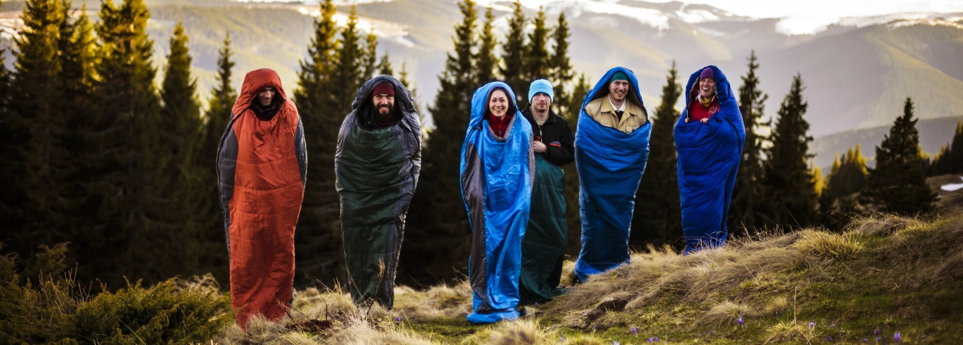 Group of friends in sleeping bags