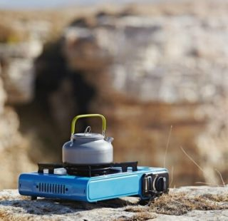 Camping stove perched on a rock