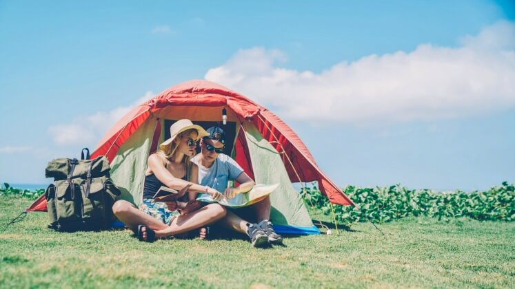 Young couple camping in the hot summer weather
